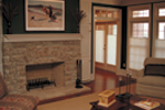French doors access this lovely hearth room.