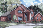Grand Columns Flank The Front Entry Of This Luxurious Two-Story Brick Home