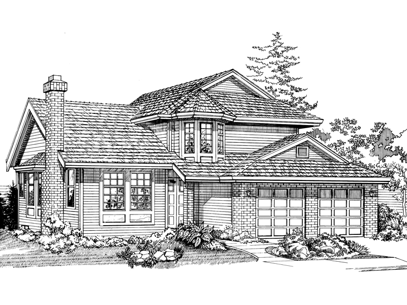 Traditional Two-Story Home Has Many Windows And Front Loading Garage
