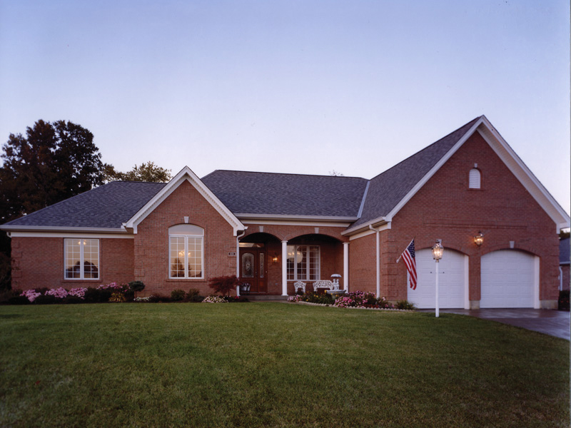 Traditional Two-Story Home With Siding Exterior And Side Entry Garage