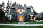 Stone And Shingle Siding Give Old World Feel To This Home Design