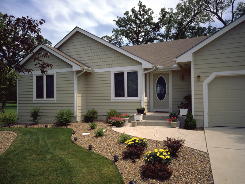 Traditional Ranch Has Siding Exterior And Victorian Door With Oval Shaped Window