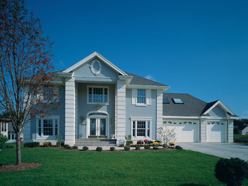 Elegant Stucco Two-Story With Georgian Style Inspiration