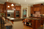 Craftsman House Plan Kitchen Photo 01 - 076D-0204 | House Plans and More