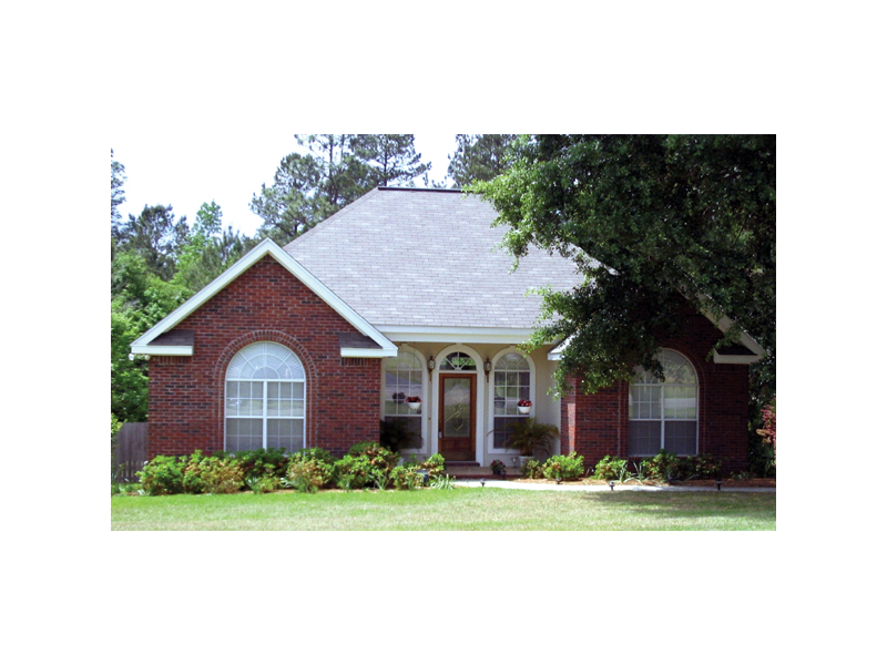 Stylish Arched Windows Cover The Front Of This Ranch Home