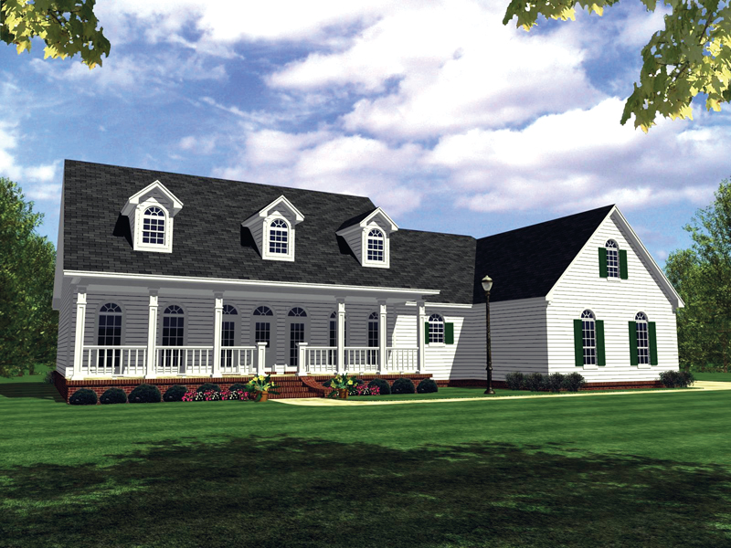 A Trio Of Dormers Accentuate This Country Home