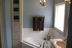 Ranch House Plan Master Bathroom Photo 01 - 077D-0097 | House Plans and More