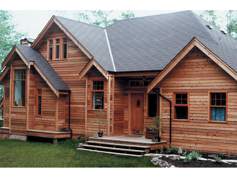 Contemporary Log Design With Interesting Gabled Roofline