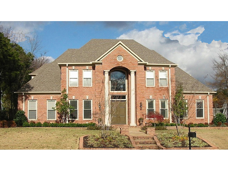 Traditional Luxury Brick Two-Story House With Grand Porch Pillars