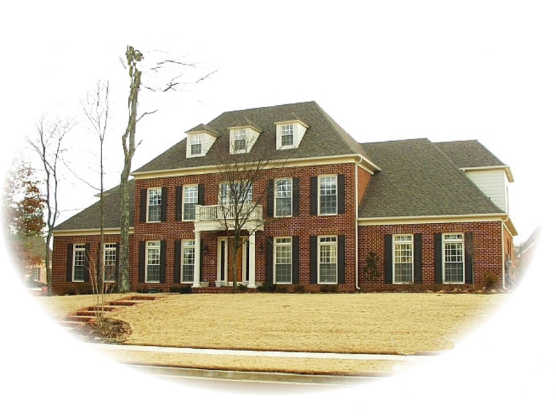 Symetrically Pleasing Georgian Style Brick Two-Story