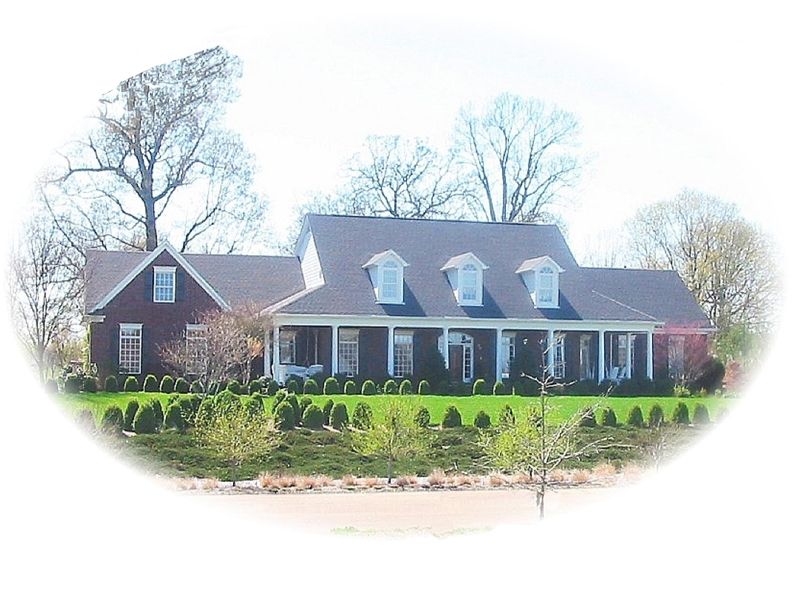 Country Style Home Has Triple Dormers And Covered Porch
