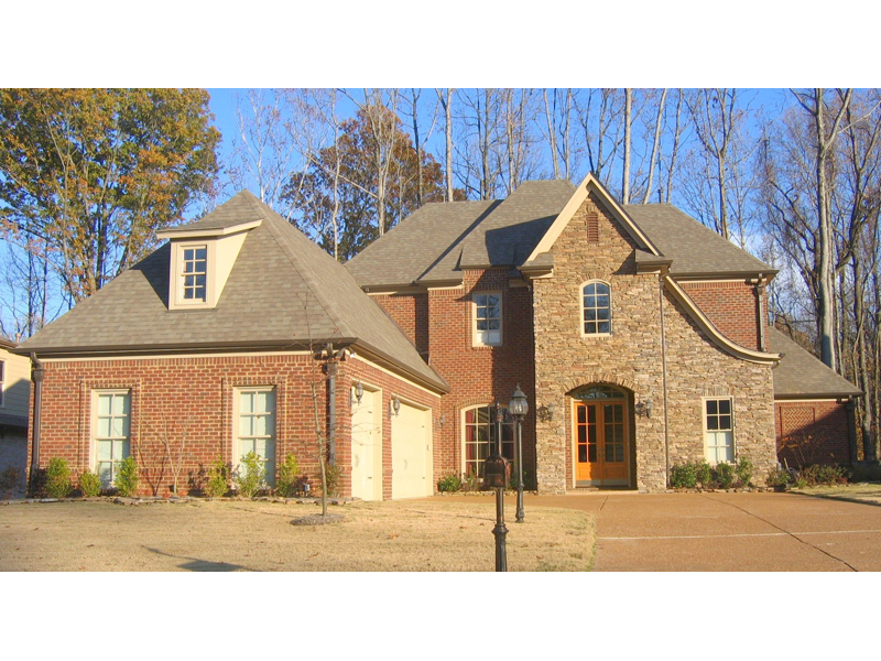 Country French Home With Luxurious Two-Story Foyer