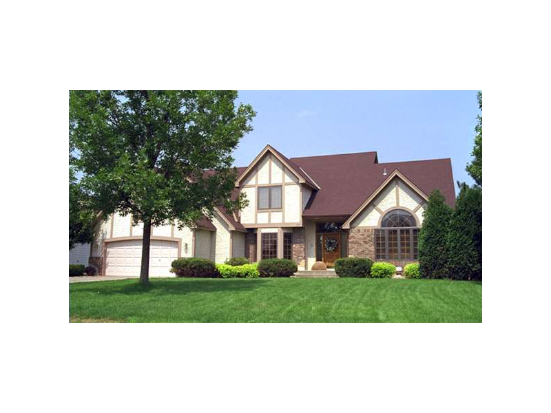 Tudor Style House With Soothing Wood Trim Details
