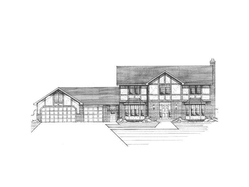 Decorative Trim And Bay Windows Capture This Tudor Style Home