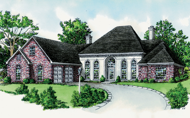 The Center Portion Of This Home Is Stucco With Arched Windows And Entry