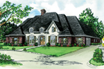 European Influenced Ranch Home With Brick, Stucco And Unique Dormers
