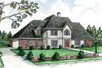 Two-Story Home Has European Style With Stucco And Brick
