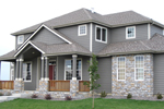 Stone Adds great Craftsman Style To The Exterior Of This Two-Story House
