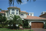 Eye-Catching Stucco Siding And Clay Roof