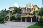 Mediterranean Stucco Home With Clay Tile Roof