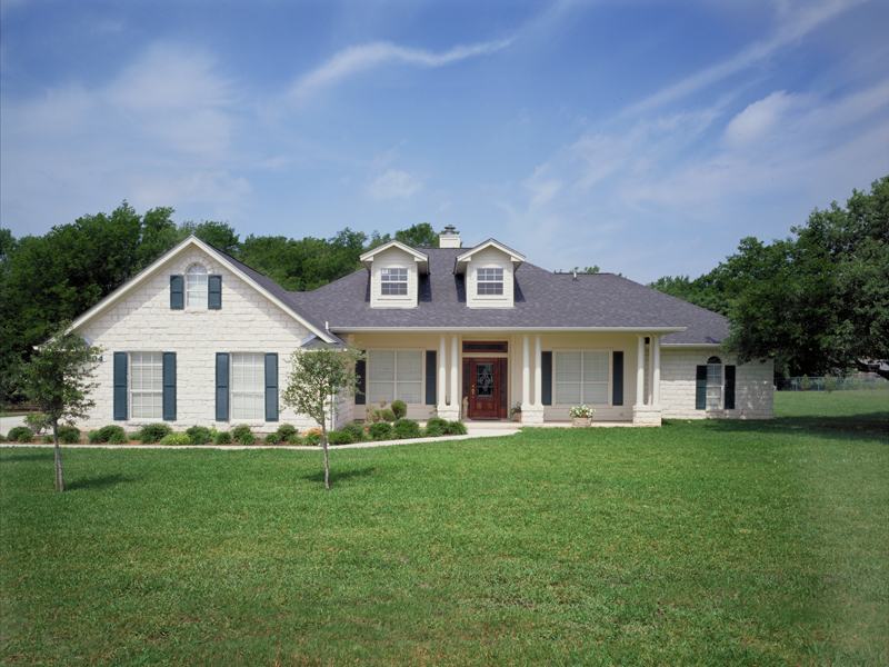 Large Front Porch With Columns Enhances Façade